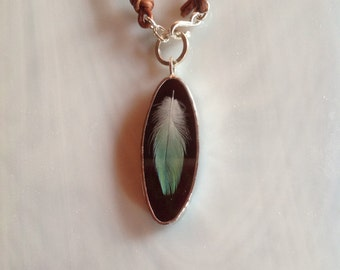 Dark Mahogany Brown Stained Glass Pendant with wispy Aqua Feather