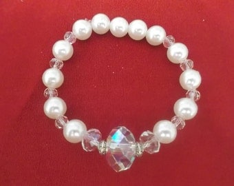 Faux pearl with large crystal