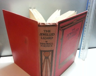 The Jewelled Lizard by W Dingwall Fordyce, fair condition hardback book. some foxing on pages. Thomas Nelson and sons