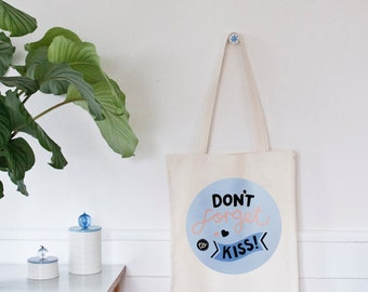 Don't forget to kiss tote bag. Illustrated motif on unbleached, long handles, organic fairtrade cotton, screen printed.