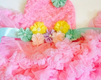 Full and fluffy pettiskirt dress with a floral pastel sash.