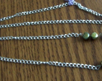 Irridescent olive and light green freshwater pearl necklace  silver chain about 30 inches Classy
