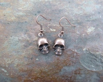 Copper Colored Dangle Skull Earrings