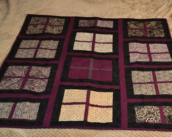 Quilted wall hanging or lap quilt. Machine pieced and quilted in beautiful purple, black & off white downtown abbey fabrics