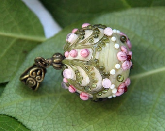 Lampwork glass pendant #4 with bronze color finding. Pink and green color. Baroque style.