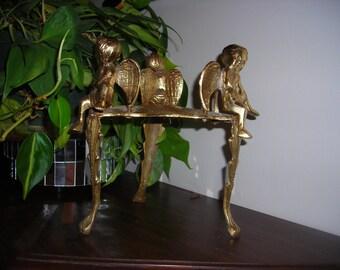Brass cherub stand