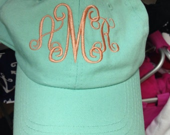 Mint hat with soroity letters or initials.