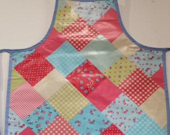 Child's wipeable apron with patchwork design.