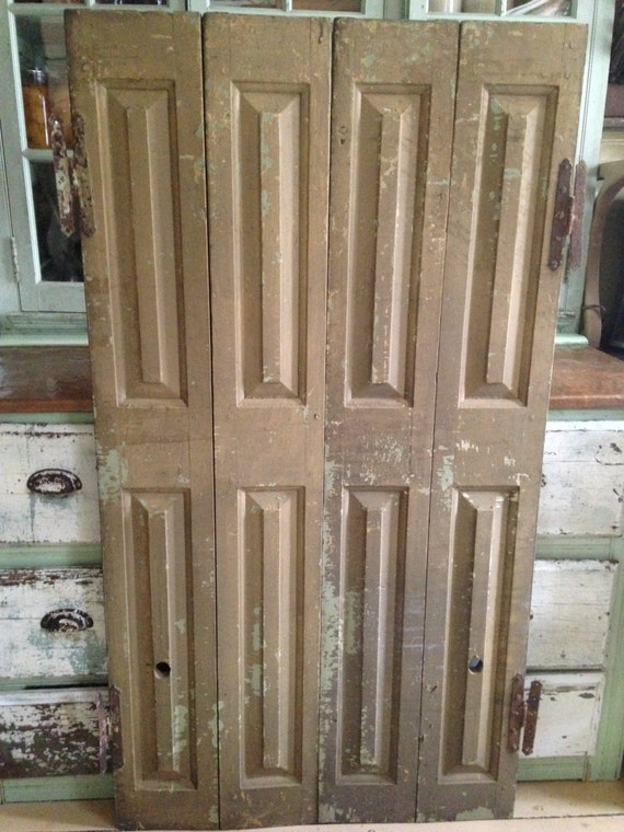Two bi fold raised panel antique wood shutterstall interior - Unfinished interior wood shutters ...