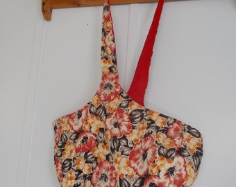 Hobo bag. Red, yellow and black flowered, red reversible