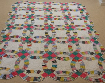 American Classic!  Pennsylvania Feed Sack, Double Wedding Ring Quilt.  1930s.