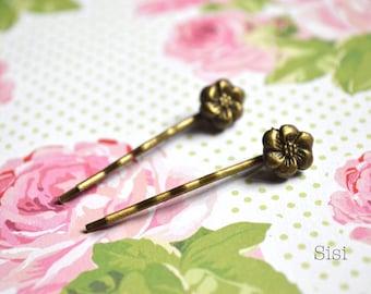 Pair of bronze flower hair barrettes