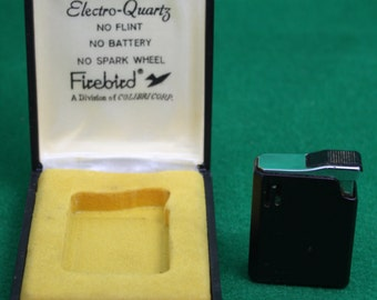 Vintage Colibri Firebird Electro Quartz Lighter with original case. Mad Men style