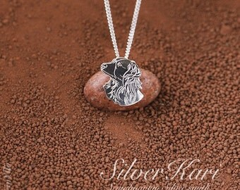 Necklace with a pendant of Kooikerhondje, all in sterling silver