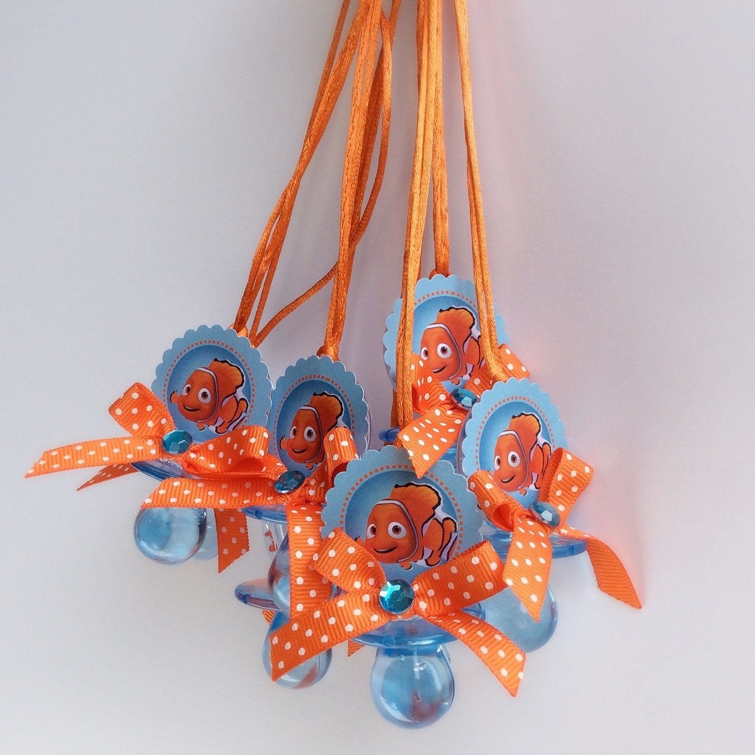 12 finding nemo pacifiers necklace finding nemo baby shower for Nemo decorations