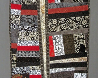 """Black white and red improvisational quilted wall hanging or table runner 14"""" x 34"""""""