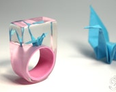 Shimmy luck - extraordinary origami crane ring with self-made folded mini-crane made of light blue paper on a light pink ring made of resin