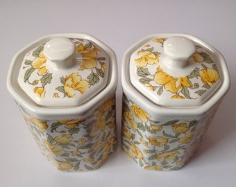 Canisters with a pretty yellow floral motif