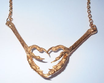 Heart Shaped Bird Claw Necklace ©
