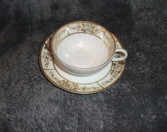 Antique, circa 1900 hand-painted, porcelain,  Nippon tea-cup and saucer