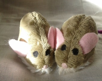 Funny furry mouse with pink ears and nose
