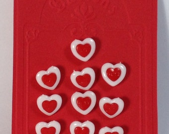 10 Buttons in plastic white and red hearts 15 mm with hook.