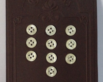 10 Buttons white in mother of pearl 10 mm 4 holes.