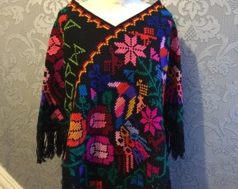 Handmade Poncho -primaveral-Embroidery cross-stitch with neon threads .