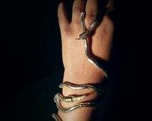 Gold/silver toned snake wrap bracelet. statement piece