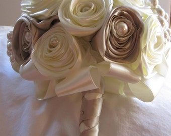 Exquisite handmade posy style bridal bouquet and matching boutonnierre of satin roses and faux pearl clusters