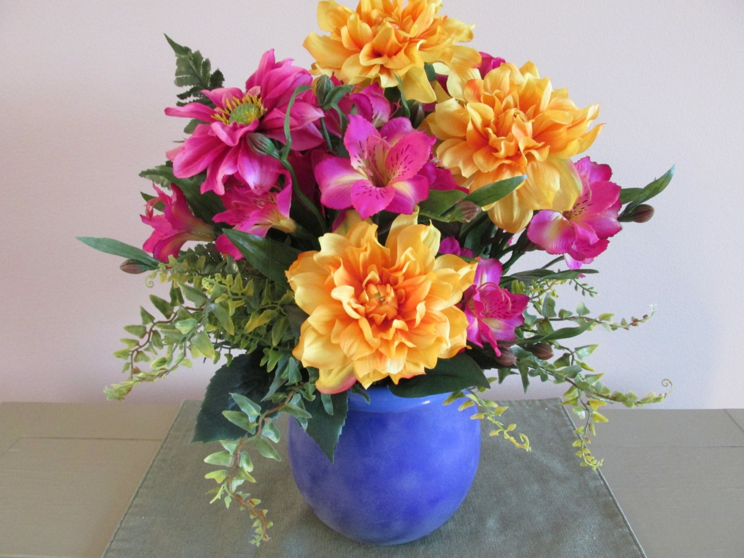 silk flower arrangement blue container