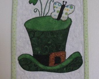 This small handmade quilted wall hanging features just  a leprechaun hat for St. Patrick's Day