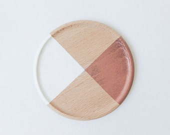 Wooden coasters painted geometric designs