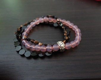 handmade pink, black, and copper stretch bracelet trio by 86proof Jewelry