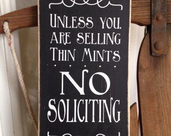"""Unless you are Selling Thin Mints, No Soliciting 12"""" x 5.5""""  Wooden Sign with Rusty Wire Hanger"""