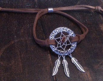 Hand made dreamcatcher bracelet / Silver coloured dreamcatcher bracelet with feather charms and brown suedine