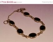 """SPRING SALE Black and Gold Tone Bracelet 8"""""""