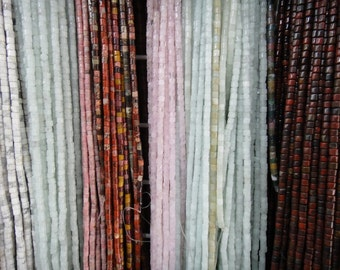 "4mm heishi beads, 16"" strand long."
