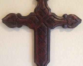 A Dark Wooden Cross.