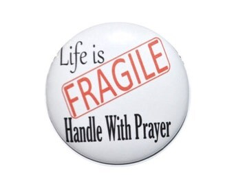 Christian Button Life is Fragile Handle With Prayer Religious pin 2 1/4 inch pin-back button.