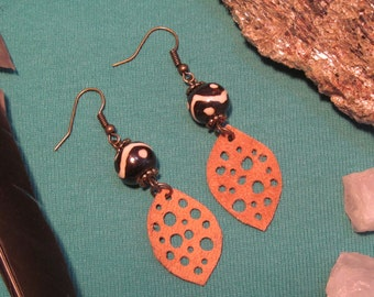 holy leaves and bone. a pair of tan leather leaf and bone bead earrings.