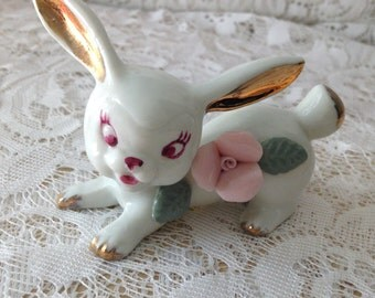 Cute vintage Porcelain Bunny Rabbit   Gold Ears, pink flower  4 inches long