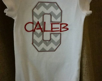 Appliqued onesie with embroidered name