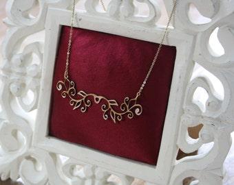 Gold laser cut leather Art Nouveau necklace