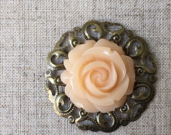 Bronze brooch/boutonniere with apricot flower.