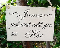 Just wait until you see her wood wedding sign. Personalized. Flower girl, ring bearer wedding board.