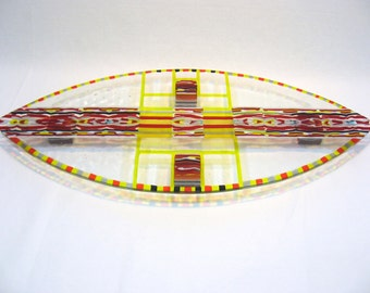 Fused glass flat serving plate. Transparrent red, black, gray and yellow. Shield Shape
