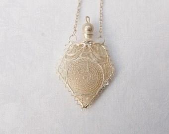Vintage Filigree Pendant  on a long chain.
