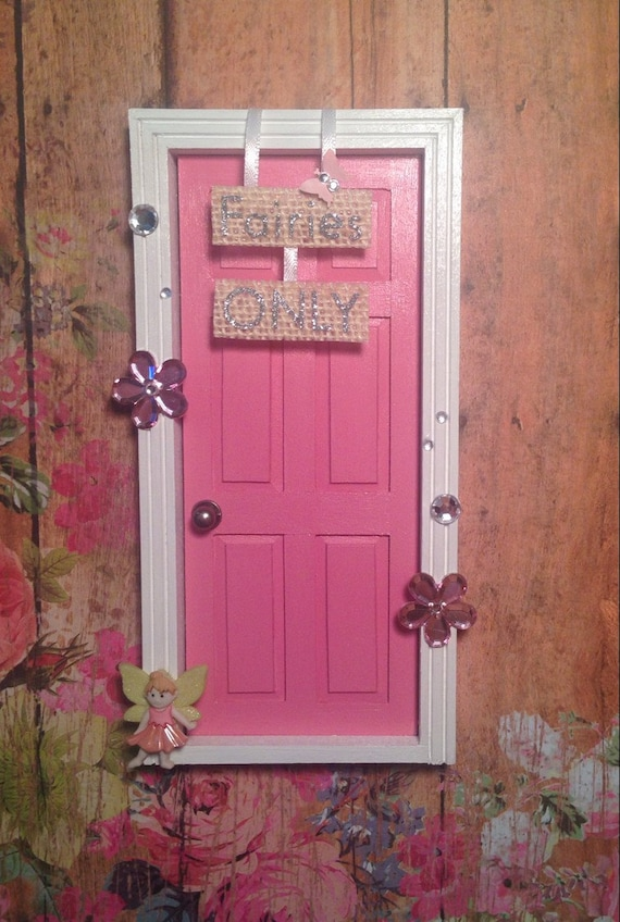 Pink fairy door with 39 fairies only 39 sign for Pink fairy door