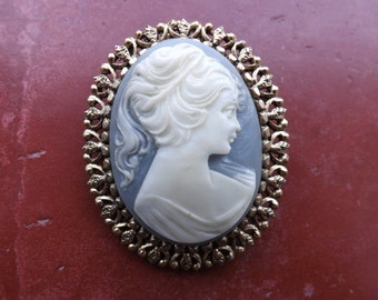 Vintage cameo brooches.